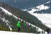 Skiers Descend On The Slopes Of The Carpathian Slopes And Mountains, On The Background Are Picturesq poster