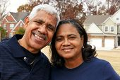 pic of senior-citizen  - Minority senior couple together outside their home - JPG