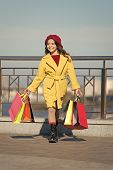 Autumn Trend. Little Girl With Purchase In Shopping Bags. Shopping Day. Happy Little Girl. Kid Fashi poster