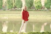 A Typical Day In Childhood. Happy Little Girl Wearing Casual Clothes For Vacation At Riverside. Chil poster