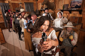 picture of gunfights  - Pretty Indian gunfighter with revolver and dagger in her mouth - JPG