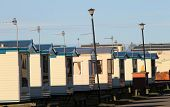 picture of trailer park  - Row of caravans in trailer park at sunset - JPG
