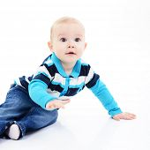 full legth portrait of cute happy smiling little boy toddler sitting in studio, 11 month, studio ove