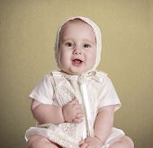 foto of christening  - a small baby with her  - JPG