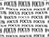 stock photo of leaked  - The word focus with blurred words in background isolated on white as concept for business ideas - JPG