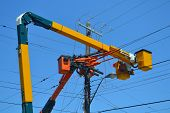 stock photo of power transmission lines  - Utility workers repairing some power lines in the city of Hamilton Ontario