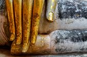 image of chums  - Beautiful golden hand of sitting Buddha in Wat Si Chum temple in Sukhothai Thailand - JPG