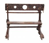 foto of humiliation  - medieval pillory antique device used for punishment by public humiliation and physical abuse  - JPG