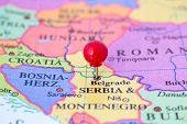 stock photo of serbia  - Round red thumb tack pinched through city of Belgrade on Serbia and Montenegro map - JPG