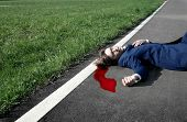 picture of blood drive  - a man dead with a rush of blood on the street - JPG
