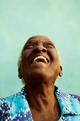 foto of tilt  - Old people and emotions portrait of bizarre senior african american lady laughing with head tilted up - JPG