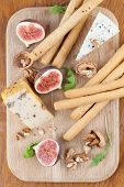 Постер, плакат: Cheese Board With Figs And Nuts