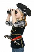 foto of pirate girl  - Six years girl wearing costume of pirate looking away through the binoculars over white background - JPG