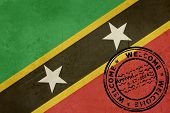 Welcome to Saint Kitts and Nevis flag with passport stamp