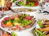 stock photo of collate  - Various meat slices on white plate - collation