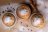 image of chocolate muffin  - Three muffins with icing sugar and chocolate balls - JPG