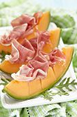 picture of cantaloupe  - Fresh Cantaloupe Melon with Prosciutto and  Arugula - JPG