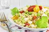 picture of tabouleh  - Tabbouleh made with bulgar, edamame, red and yellow cherry tomatoes, green onions, cilantro, crumbled feta cheese and a lemon pesto dressing ** Note: Shallow depth of field - JPG