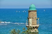 stock photo of israel people  - Views of the Mediterranean with a tower and sailing boats from Jaffa Tel Aviv Israel - JPG