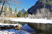stock photo of granite dome  - Half Dome and its reflection in the Merced River  - JPG