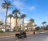 Tangier, Morocco - March 22, 2014: Old Tricycle Cargo Bike With Arab Driver Rides On The Street