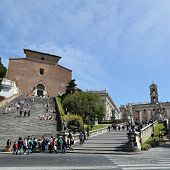 Tourists climb the stairs to Capitoline in Rome, Italy. Capitol Hill