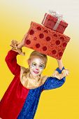 Smiling girl clown with big presents on her head