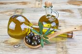 picture of kalamata olives  - Smart bottle of olive oil and wooden spoon with black olives - JPG