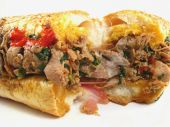 stock photo of cheesesteak  - A Philadelphia cheesesteak sandwhich with prosciutto - JPG