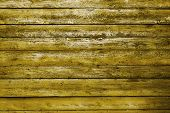 painted old wooden wall. yellow background
