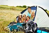 Group people with backpack in tent summer outdoor.