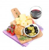Red wine with cheese, bread, olives and spices. Isolated on white background