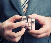 Businessman holding cube in his hands