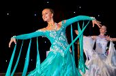 stock photo of waltzing  - Female dancer performs at dance championship - JPG