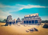Vintage retro hipster style travel image of Five Rathas - ancient Hindu monolithic Indian rock-cut a