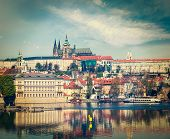 Vintage retro hipster style travel image of Charles bridge over Vltava river and Gradchany (Prague C