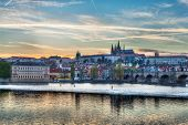 HDR image of view of Charles bridge over Vltava river and Gradchany (Prague Castle) and St. Vitus Ca