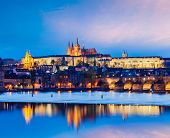 Travel Prague Europe concept background - view of Charles Bridge and Prague Castle in twilight. Prag