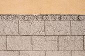 foto of tile cladding  - Ornamental wall cladding using granite bricks with floral motives - JPG
