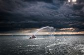 picture of polonia  - small fireboat demonstrating its capabilities on Baltic Sea in Gdansk Poland