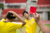 image of referee  - Referee soccer recorded player foul in the game  - JPG
