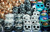 picture of day dead skull  - Traditional mexican day of the dead souvenir ceramic skulls at market stall - JPG