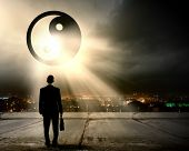 picture of yang  - Rear view of businessman looking at yin yang sign - JPG