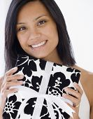 pic of pacific islander ethnicity  - Pacific Islander woman holding gift - JPG