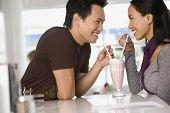 picture of pacific islander ethnicity  - Asian couple sharing milkshake - JPG
