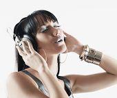 foto of pacific islander ethnicity  - Pacific Islander woman listening to headphones - JPG