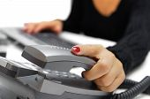 image of telephone operator  - call operator is picking up phone in office - JPG