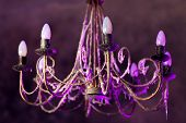 foto of chandelier  - Retro chandelier with soft purple light - JPG