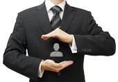 foto of human resource management  - Human resources managment concept with businessman protecting employee - JPG