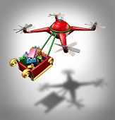 pic of sled  - Drone holiday gifts delivery as a christmas sled concept transporting presents with a santa clause flying quadrocopter delivering cargo as a symbol of new transport technology - JPG
